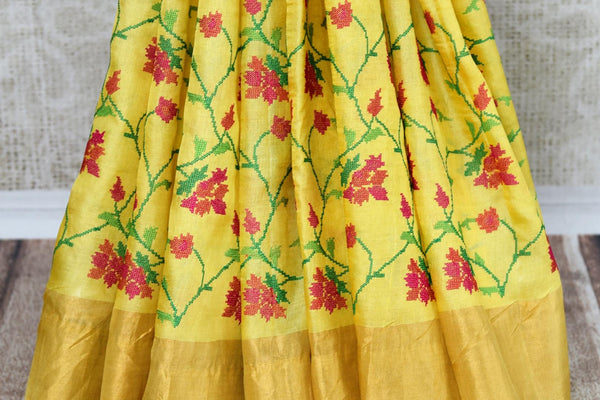 Buy yellow tussar silk saree online in USA with resham floral embroidery. The classic drape is a perfect choice for festive and special occasions. For more such Indian designer sarees in USA, shop from the exquisite collection at Pure Elegance Indian clothing store.-pleats