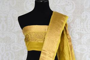 Buy yellow muga Banarasi sari online in USA with applique work. The beautiful saree is a perfect choice for festive and special occasions. For more such Indian designer sarees in USA, shop from the exquisite collection at Pure Elegance Indian clothing store.-blouse pallu
