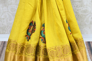 Buy yellow muga Banarasi sari online in USA with applique work. The beautiful saree is a perfect choice for festive and special occasions. For more such Indian designer sarees in USA, shop from the exquisite collection at Pure Elegance Indian clothing store.-pleats