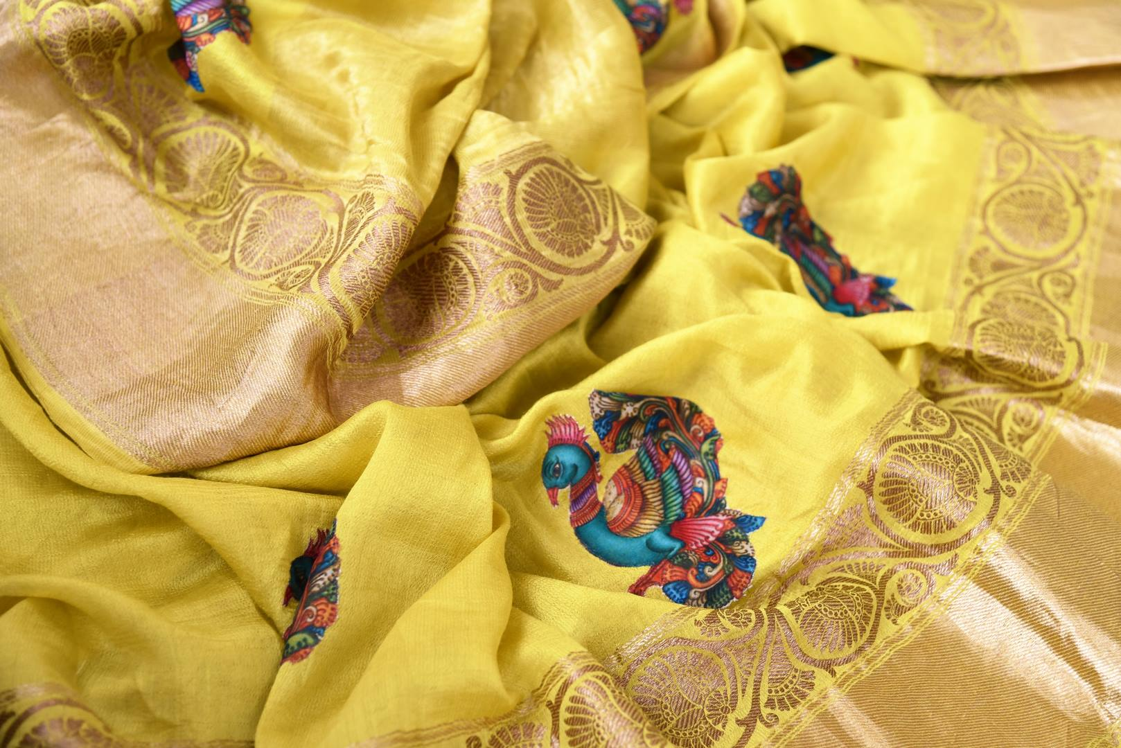 Buy yellow muga Banarasi sari online in USA with applique work. The beautiful saree is a perfect choice for festive and special occasions. For more such Indian designer sarees in USA, shop from the exquisite collection at Pure Elegance Indian clothing store.-details
