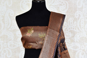 Buy brown printed muga Banarasi saree online in USA. The beautiful saree is a perfect choice for festive and special occasions. For more such Indian designer sarees in USA, shop from the exquisite collection at Pure Elegance Indian clothing store.-blouse pallu