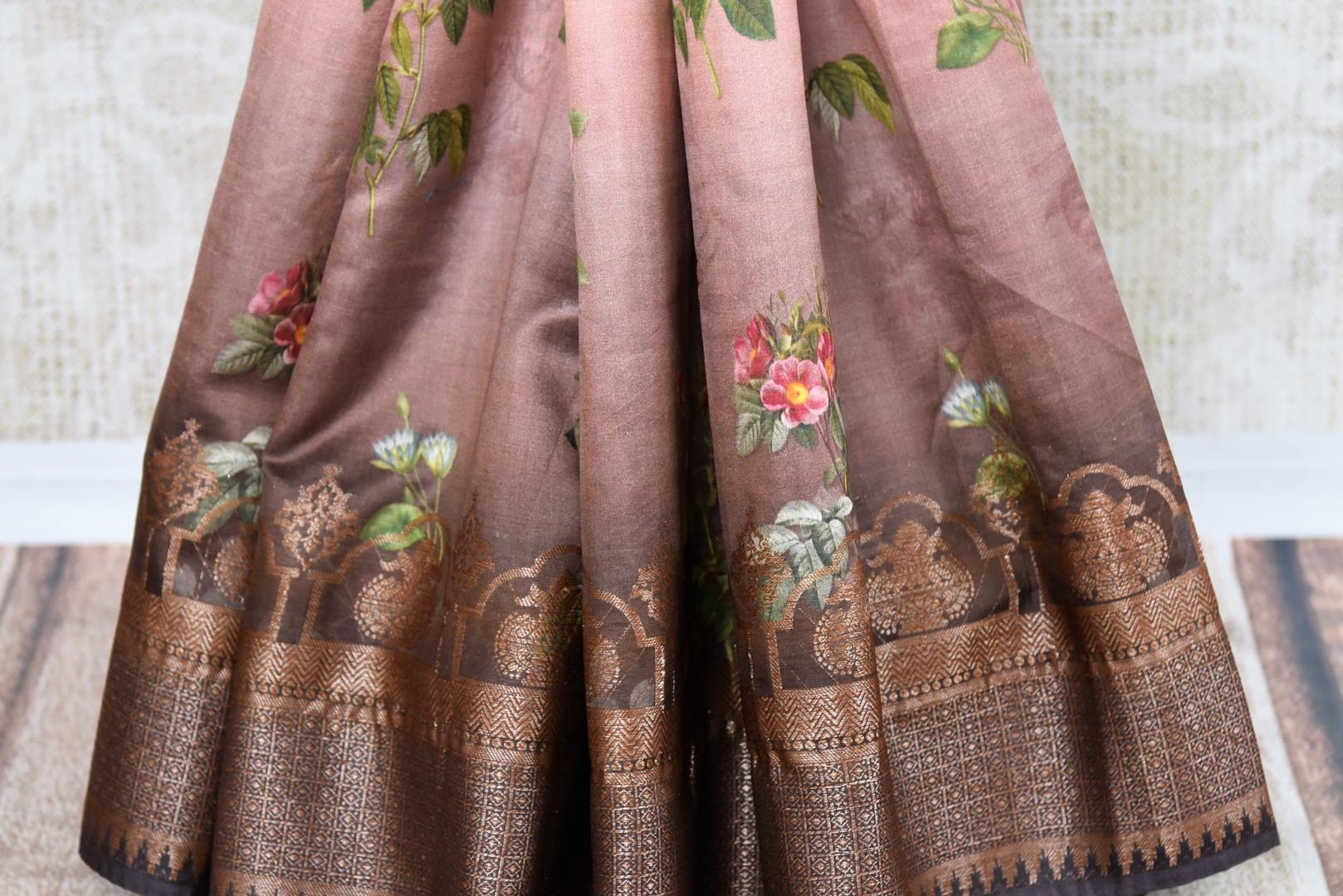 Buy brown printed muga Banarasi saree online in USA. The beautiful saree is a perfect choice for festive and special occasions. For more such Indian designer sarees in USA, shop from the exquisite collection at Pure Elegance Indian clothing store.-pleats