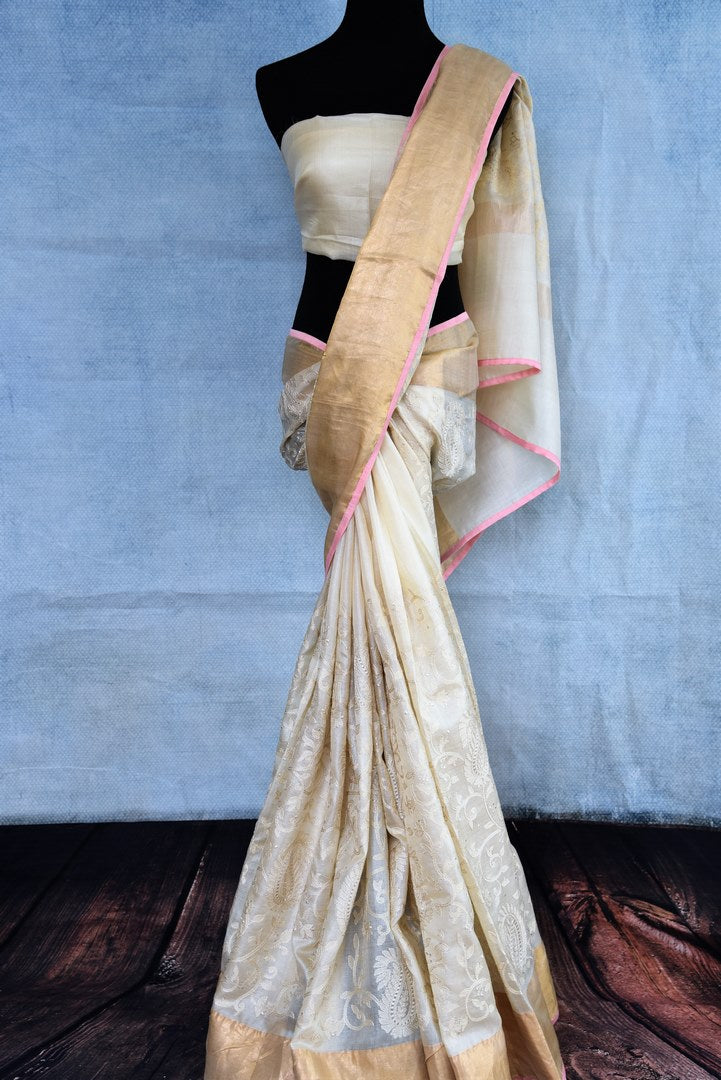 Buy online off-white embroidered Maheshwari silk saree in USA with golden border. The handwoven sari is a graceful choice for special occasions. Add more such beautifully woven Indian sarees to your ethnic wardrobe from Pure Elegance exclusive Indian clothing store in USA or shop online.-full view