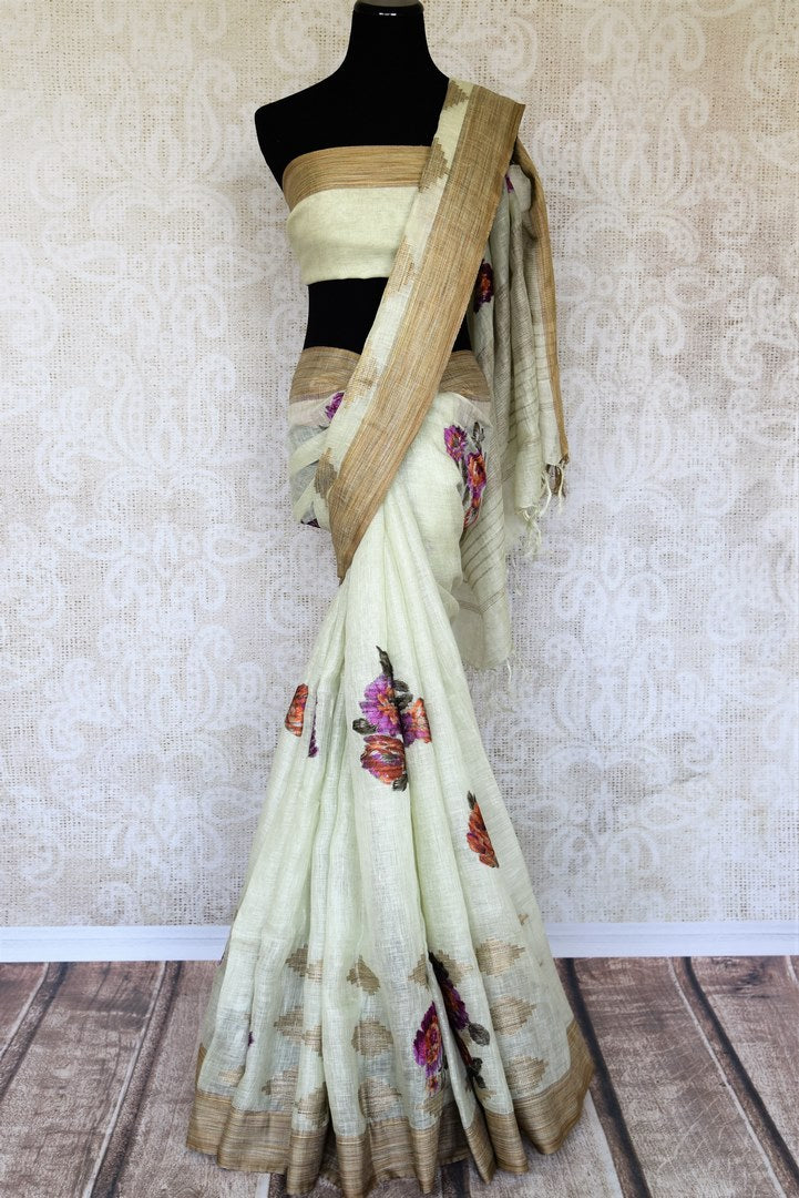 The traditional art form of applique work is beautifully showcased in white linen saree with light brown border all over it. This aesthetically appealing sari is available online and Indian designer saris are in vogue. Shop this season handloom sarees, kanjeevaram silk saris online or visit Pure Elegance store in USA. -full view