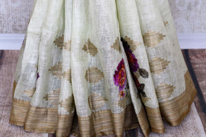 The traditional art form of applique work is beautifully showcased in white linen saree with light brown border all over it. This aesthetically appealing sari is available online and Indian designer saris are in vogue. Shop this season handloom sarees, kanjeevaram silk saris online or visit Pure Elegance store in USA. -pleats