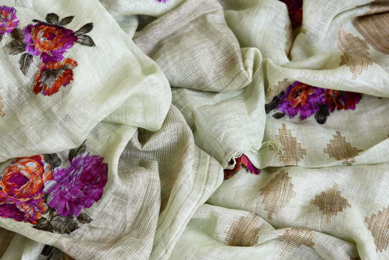 The traditional art form of applique work is beautifully showcased in white linen saree with light brown border all over it. This aesthetically appealing sari is available online and Indian designer saris are in vogue. Shop this season handloom sarees, kanjeevaram silk saris online or visit Pure Elegance store in USA. -details