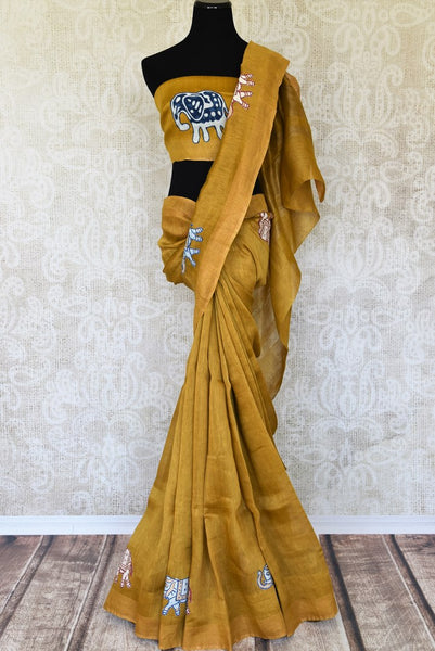 Indulge in the sheer beauty of this yellow linen saree with gorgeous applique work all over. This artistic sari comes with a matching yellow blouse featuring intricate applique work. Shop designer linen sarees, printed saris, Indian dresses, lehenga choli, anarkali suit online or visit Pure Elegance store, USA. -full view