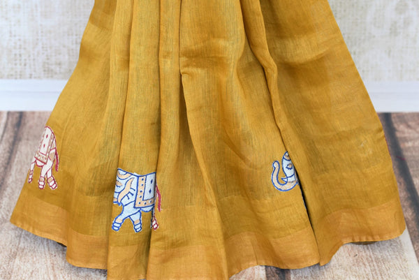 Indulge in the sheer beauty of this yellow linen saree with gorgeous applique work all over. This artistic sari comes with a matching yellow blouse featuring intricate applique work. Shop designer linen sarees, printed saris, Indian dresses, lehenga choli, anarkali suit online or visit Pure Elegance store, USA. -pleats
