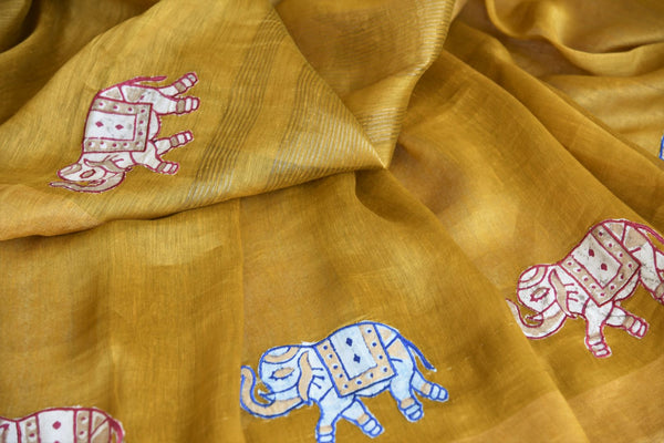 Indulge in the sheer beauty of this yellow linen saree with gorgeous applique work all over. This artistic sari comes with a matching yellow blouse featuring intricate applique work. Shop designer linen sarees, printed saris, Indian dresses, lehenga choli, anarkali suit online or visit Pure Elegance store, USA. -details