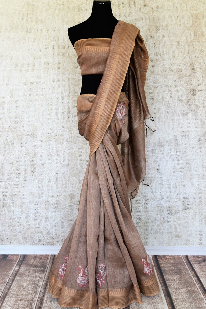 Be a perfect host in this chic grey linen saree with delicate applique work all over it. Style this beautiful saree with a matching grey blouse and gold details. The gorgeous gold details flow all throughout the border.  Shop silk saris, printed sarees, ikkat saris online or visit Pure Elegance store, USA. -full view