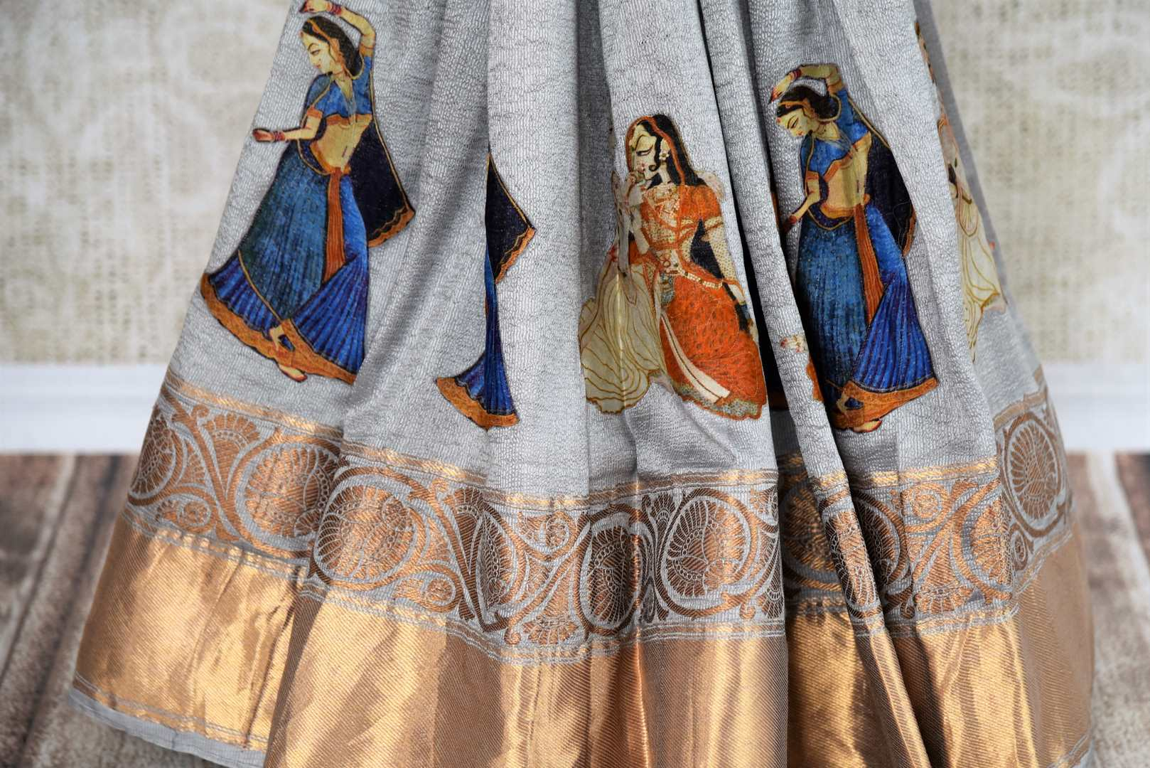 Buy elegant grey muga Banarasi saree online in USA with applique work. The saree is a classic choice for parties and special occasions. For Indian women in USA, Pure Elegance brings a range of stunning Indian handloom saris online and at their exclusive fashion store in USA.-pleats