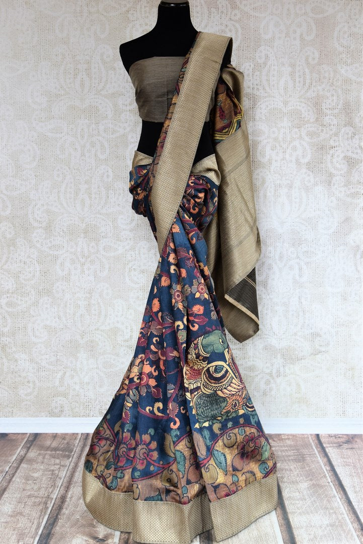 Buy blue Kalamkari print silk sari online in USA with zari border. The saree is a striking drape for festivals and special occasions. If you are looking for Indian handloom sarees in USA, then Pure Elegance is the place for you. Shop online or visit our exclusive fashion store in USA.-full view