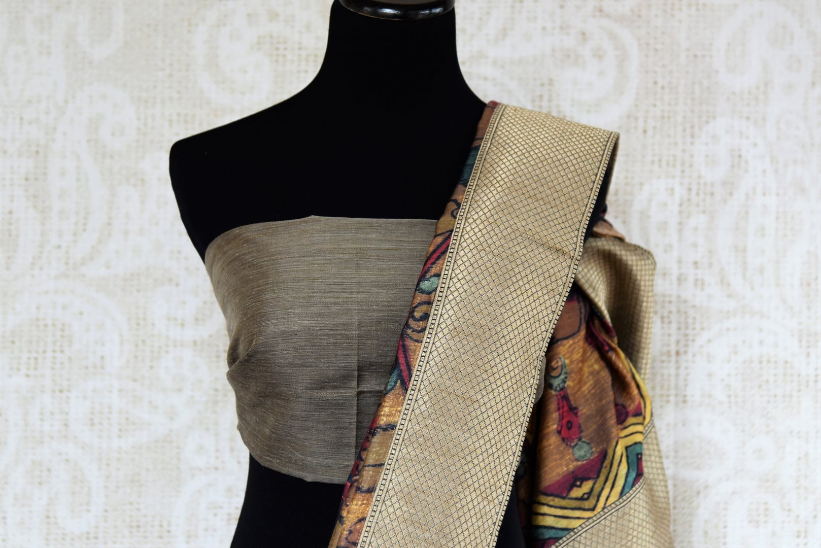 Buy blue Kalamkari print silk sari online in USA with zari border. The saree is a striking drape for festivals and special occasions. If you are looking for Indian handloom sarees in USA, then Pure Elegance is the place for you. Shop online or visit our exclusive fashion store in USA.-blouse pallu