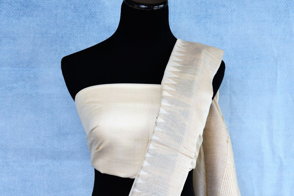 Buy off-white designer tussar silk saree online in USA. The saree is adorned with unique floral and fauna design which makes it absolutely one of a kind. Add more such beautiful Indian handloom sarees to your ethnic wardrobe from Pure Elegance exclusive Indian clothing store in USA or shop online.-blouse pallu