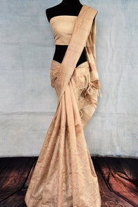 Buy beige embroidered tussar saree online in USA. The saree is adorned with delicate embroidery which makes it absolutely one of a kind. Add more such beautiful Indian handloom sarees to your ethnic wardrobe from Pure Elegance exclusive Indian clothing store in USA or shop online.-full view