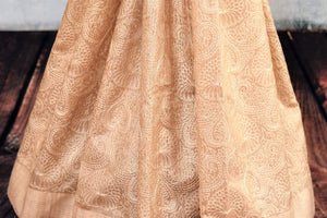 Buy beige embroidered tussar saree online in USA. The saree is adorned with delicate embroidery which makes it absolutely one of a kind. Add more such beautiful Indian handloom sarees to your ethnic wardrobe from Pure Elegance exclusive Indian clothing store in USA or shop online.-pleats