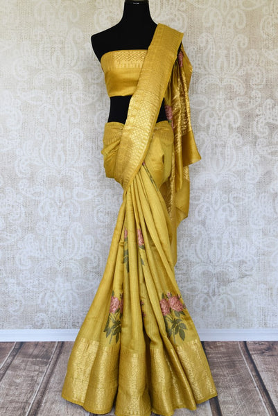 Shop the designer Muga Banarsi silk saree intricately woven with floral threadwork on the hem. The rich zari border adds a touch of royalty. Shop this exclusive and authentic Muga Banarsi silk saree, designer silk saris and printed sarees online or visit Pure Elegance store in USA. -full view