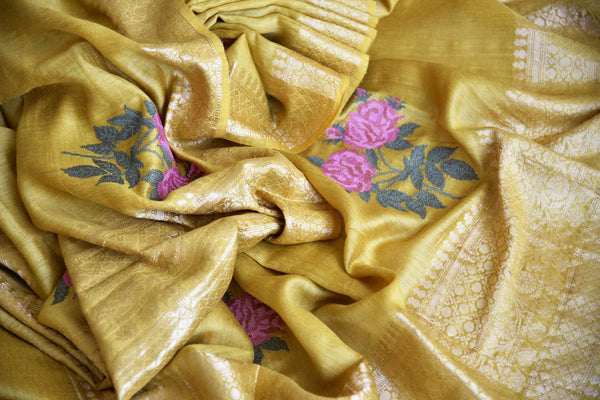 Shop the designer Muga Banarsi silk saree intricately woven with floral threadwork on the hem. The rich zari border adds a touch of royalty. Shop this exclusive and authentic Muga Banarsi silk saree, designer silk saris and printed sarees online or visit Pure Elegance store in USA. -details