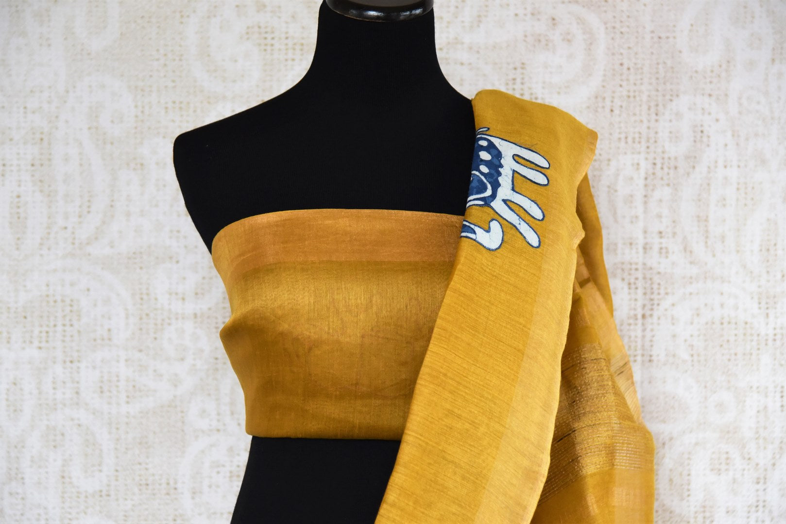Mustard yellow tussar silk saree for online shopping in USA with Kalamkari applique work. Beautifully designed woven sari is a graceful choice for special occasions. Shop Indian handloom sarees, silk saris in USA from an alluring collection available at Pure Elegance fashion store.-blouse pallu