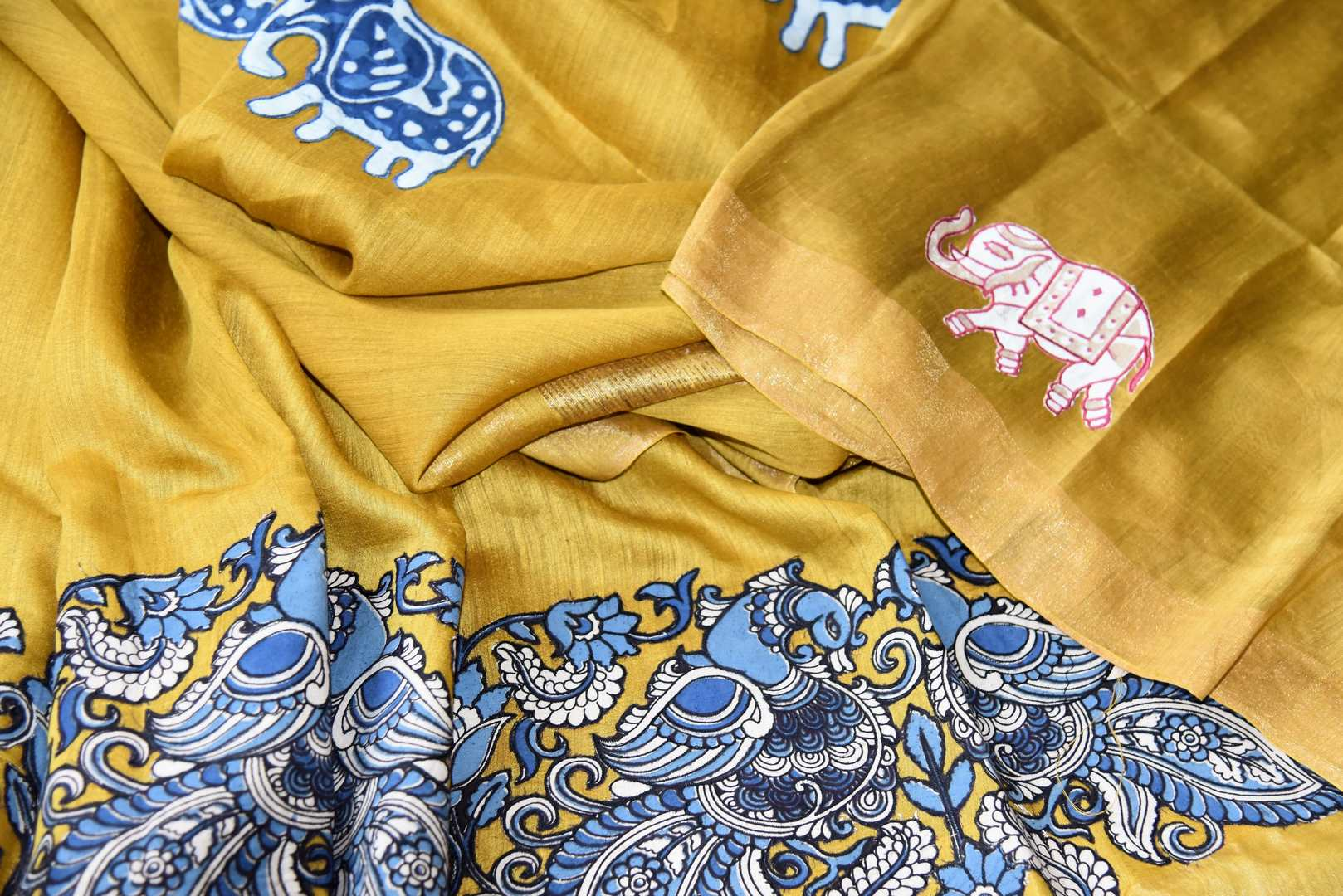 Mustard yellow tussar silk saree for online shopping in USA with Kalamkari applique work. Beautifully designed woven sari is a graceful choice for special occasions. Shop Indian handloom sarees, silk saris in USA from an alluring collection available at Pure Elegance fashion store.-details