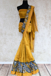 Mustard yellow tussar silk saree buy online in USA with Kalamkari applique work. Beautifully designed woven saree is a graceful choice for special occasions. Shop Indian handloom saris, silk sarees in USA from an alluring collection available at Pure Elegance fashion store.-full view