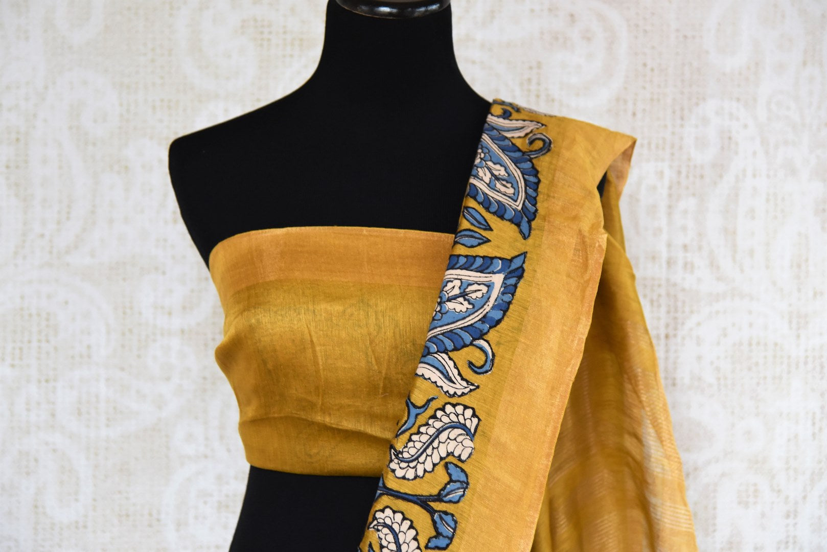 Mustard yellow tussar silk saree buy online in USA with Kalamkari applique work. Beautifully designed woven saree is a graceful choice for special occasions. Shop Indian handloom saris, silk sarees in USA from an alluring collection available at Pure Elegance fashion store.-blouse pallu