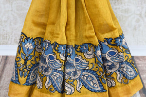 Mustard yellow tussar silk saree buy online in USA with Kalamkari applique work. Beautifully designed woven saree is a graceful choice for special occasions. Shop Indian handloom saris, silk sarees in USA from an alluring collection available at Pure Elegance fashion store.-pleats