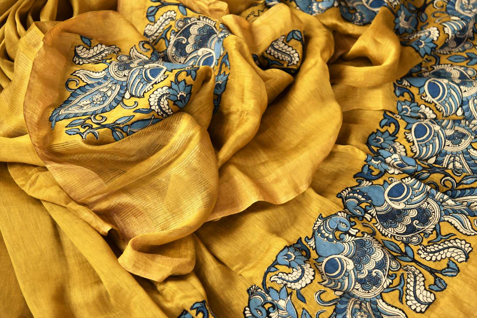 Mustard yellow tussar silk saree buy online in USA with Kalamkari applique work. Beautifully designed woven saree is a graceful choice for special occasions. Shop Indian handloom saris, silk sarees in USA from an alluring collection available at Pure Elegance fashion store.-details