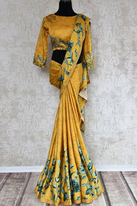 Buy yellow printed crepe silk sari online in USA with stonework. The stylish saree is a perfect choice for festive and special occasions. For more such Indian designer sarees in USA, shop from the exquisite collection at Pure Elegance Indian clothing store.-full view