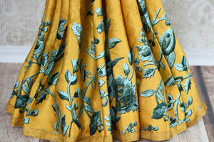 Buy yellow printed crepe silk sari online in USA with stonework. The stylish saree is a perfect choice for festive and special occasions. For more such Indian designer sarees in USA, shop from the exquisite collection at Pure Elegance Indian clothing store.-pleats