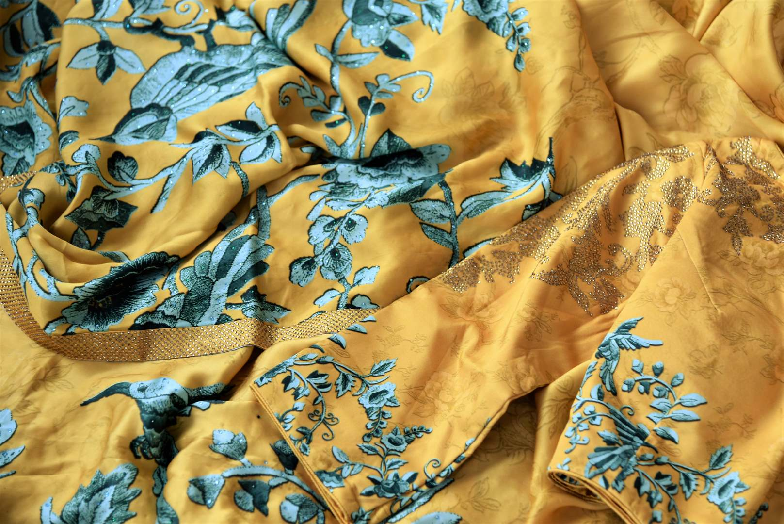 Buy yellow printed crepe silk sari online in USA with stonework. The stylish saree is a perfect choice for festive and special occasions. For more such Indian designer sarees in USA, shop from the exquisite collection at Pure Elegance Indian clothing store.-details