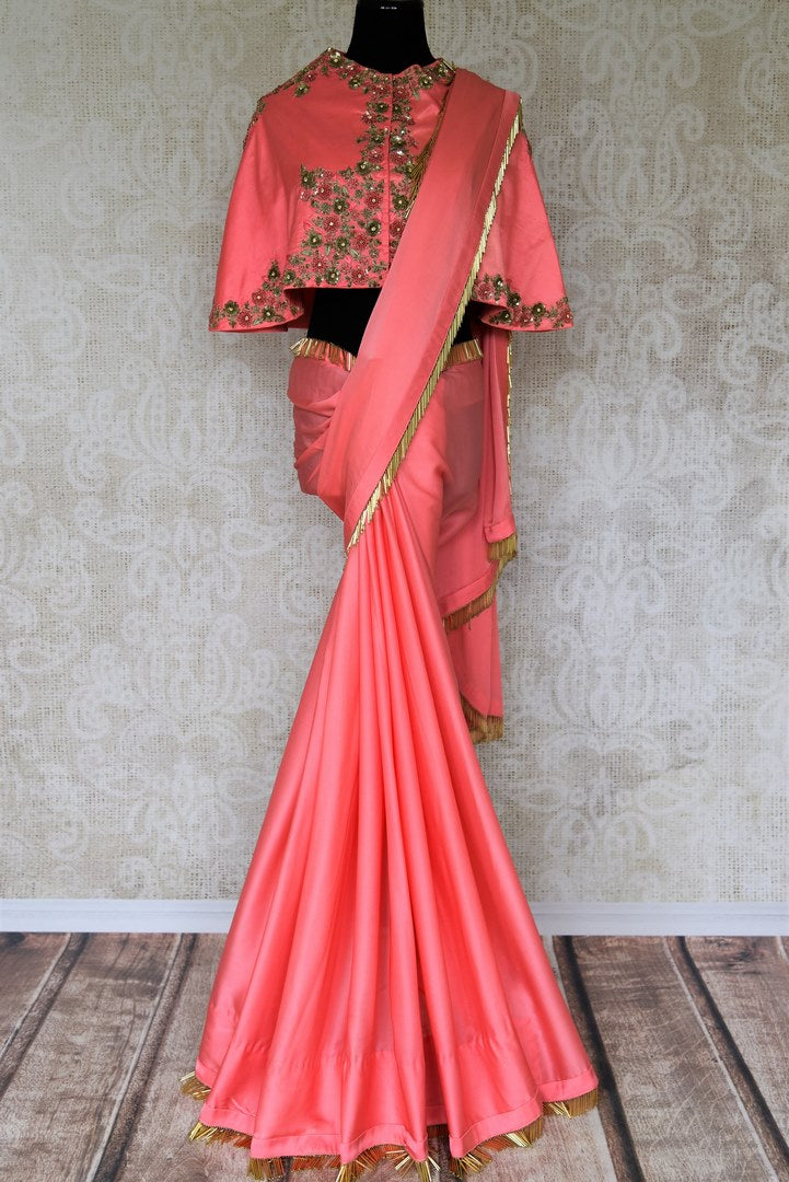 Stun the coterie in this ecstatic soft pink designer crepe silk sari complemented with a graceful designer blouse. Up your style quotient with gold piping on the border and zardozi embroidered blouse. Shop such handcrafted beautiful silk sari, ikkat saree, kalamkari saree online or visit Pure Elegance store in USA. -full view