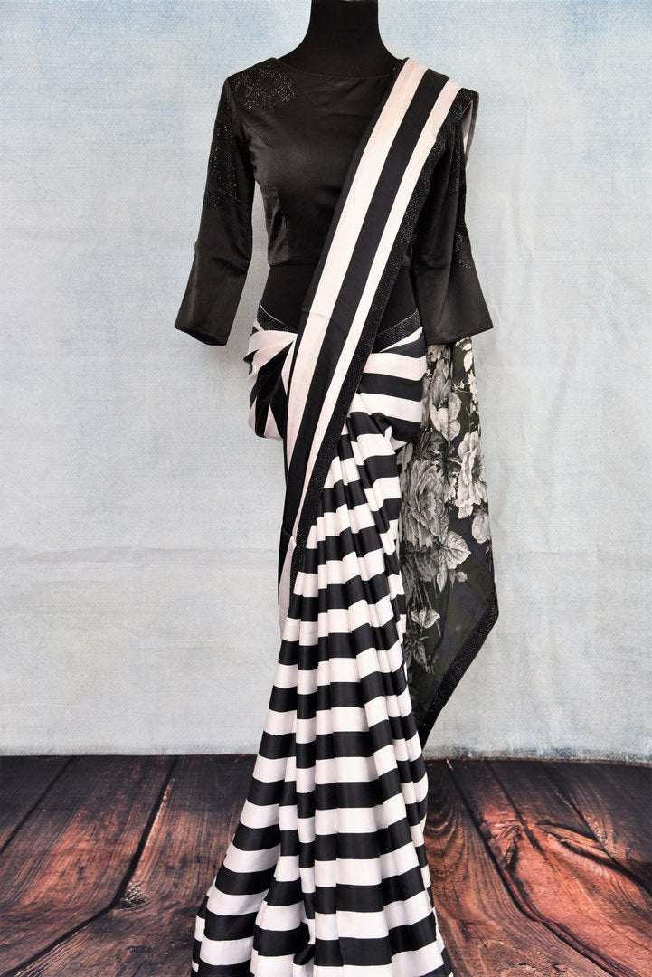 Buy black and white striped stonework crepe silk saree online in USA. The saree comes with a stylish black designer saree blouse to complete your party look. Add more such beautiful Indian designer sarees to your ethnic wardrobe from Pure Elegance exclusive Indian clothing store in USA or shop online.-full view