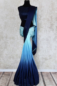 Buy elegant ombre blue crepe silk designer saree online in USA with swarovski stone work. The saree comes with a designer blouse perfect for a dazzling saree look. Spoil yourself with an exquisite collection of Indian designer sarees in USA available at Pure Elegance Indian clothing store.-full view