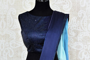 Buy elegant ombre blue crepe silk designer saree online in USA with swarovski stone work. The saree comes with a designer blouse perfect for a dazzling saree look. Spoil yourself with an exquisite collection of Indian designer sarees in USA available at Pure Elegance Indian clothing store.-blouse pallu
