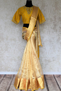 Embrace the royalty as you slip into this cream designer tissue silk saree. The breath-taking details of yellow embroidered blouse featuring intricate embroidery add oodles of grace. Shop handloom sarees, silk sari, banarsi silk saree online or visit Pure Elegance store, USA.-full view