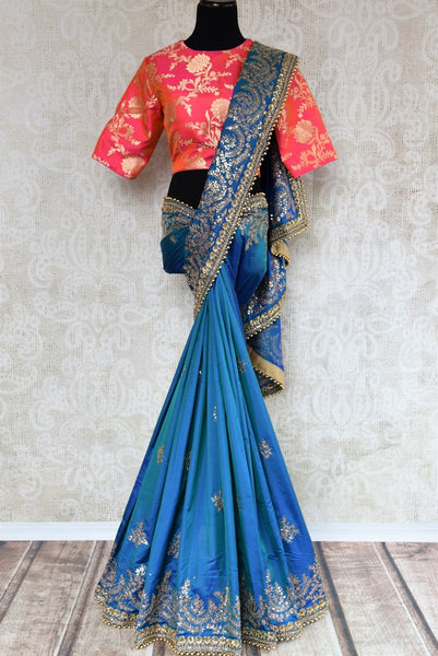 Buy blue ticki work silk sari online in USA with saree blouse. Beautifully designed saree is a captivating choice for weddings and parties. Shop Indian wedding sarees with blouses in USA from an alluring collection available at Pure Elegance fashion store-full view