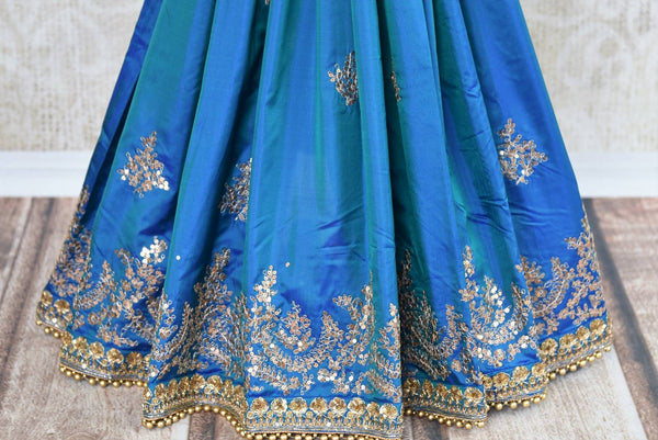Buy blue ticki work silk sari online in USA with saree blouse. Beautifully designed saree is a captivating choice for weddings and parties. Shop Indian wedding sarees with blouses in USA from an alluring collection available at Pure Elegance fashion store-pleats
