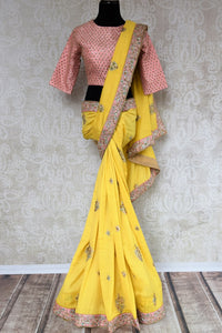 Buy yellow embroidered tussar georgette saree online in USA with silk blouse. Beautifully designed saree is a captivating choice for weddings and parties. Shop Indian wedding sarees with blouses in USA from an alluring collection available at Pure Elegance fashion store.-full view