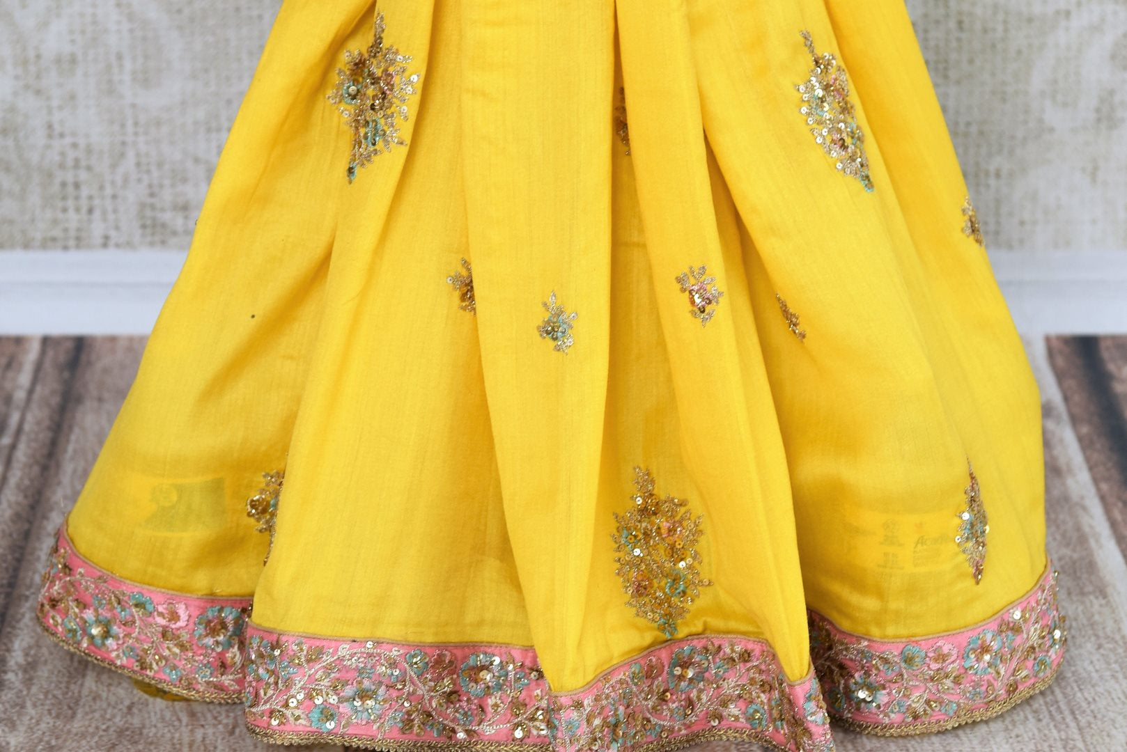 Buy yellow embroidered tussar georgette saree online in USA with silk blouse. Beautifully designed saree is a captivating choice for weddings and parties. Shop Indian wedding sarees with blouses in USA from an alluring collection available at Pure Elegance fashion store.-pleats