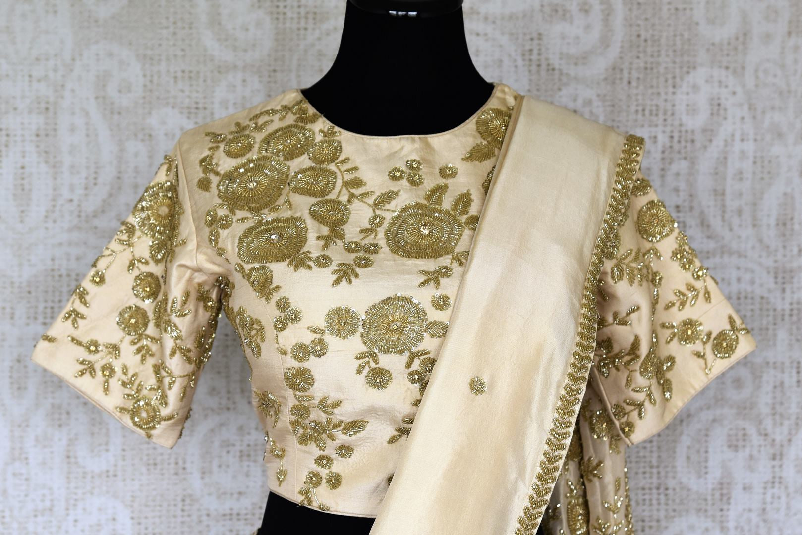 Slay effortlessly in this cream-hued satin and tissue designer silk sari. A perfect party pick, the statement embroidered blouse will steal the hearts away. Shop the beautiful Indian handprinted sarees, designer silk sarees, handblocked saris online or visit Pure Elegance store in USA. -blouse pallu