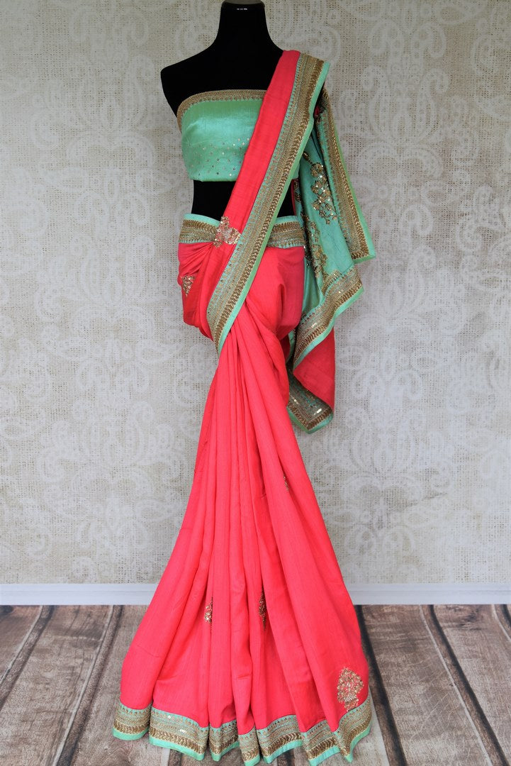 Indulge in fresh breeze and put a spring in your step as you drape this pink tussar georgette silk designer sari. Style the saree with a contrasting turquoise embroidered blouse and the heavily woven pallu. Shop designer silk saris, Indian dress, lehenga cholis, printed sarees online or visit Pure Elegance store, USA.-full view