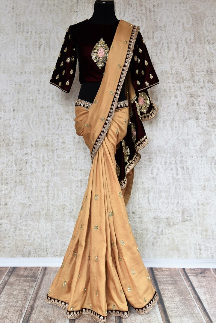 Buy beige embroidered georgette shimmer saree online in USA with velvet blouse. Beautifully designed saree is a captivating choice for weddings and parties. Shop Indian wedding sarees with blouses in USA from an alluring collection available at Pure Elegance fashion store.-full view