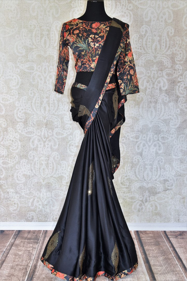 Escape into the wonderland draped in our exquisitely designed black crepe silk saree with intricate stonework. It comes with a handprinted boat neck floral blouse. Shop such handwoven silk saris, printed sarees, embroidered saris, handloom sarees online or visit Pure Elegance store in USA.-full view