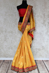 Buy beautiful yellow tussar georgette Banarasi sari online in USA with embroidery, The saree is a beautiful drape for a traditional Indian look at weddings. Find more such exquisite Indian designer sarees in USA at Pure Elegance Indian fashion store. Shop now.-full view
