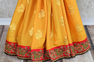 Buy beautiful yellow tussar georgette Banarasi sari online in USA with embroidery, The saree is a beautiful drape for a traditional Indian look at weddings. Find more such exquisite Indian designer sarees in USA at Pure Elegance Indian fashion store. Shop now.-pleats