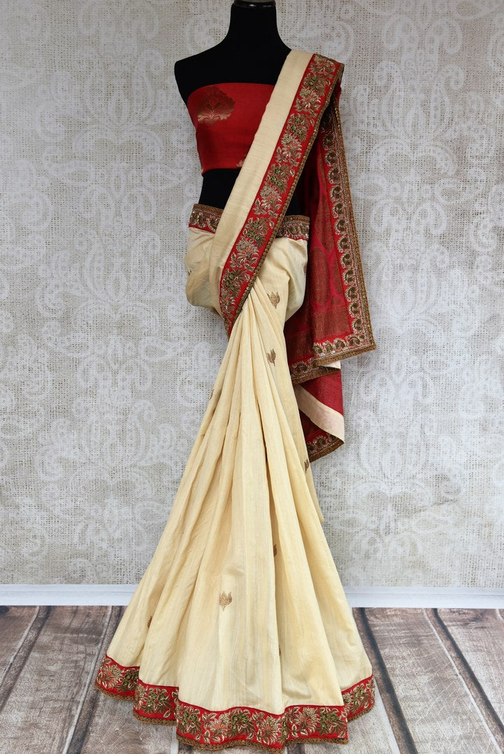 Buy beautiful cream tussar georgette Banarasi saree online in USA with embroidery, The saree is a beautiful drape for a traditional Indian look at weddings. Find more such exquisite Indian designer saris in USA at Pure Elegance Indian fashion store. Shop now.-full view