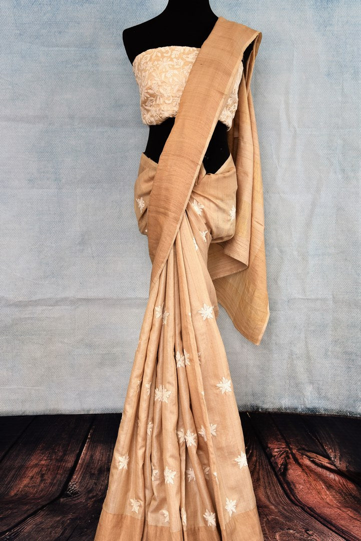 Buy elegant handwoven beige embroidered tussar silk saree online in USA. The sari comes with a matching embroidered blouse piece. Add more such beautiful Indian handloom sarees to your ethnic wardrobe from Pure Elegance exclusive Indian clothing store in USA or shop online.-full view