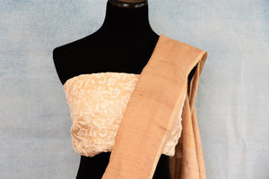 Buy elegant handwoven beige embroidered tussar silk saree online in USA. The sari comes with a matching embroidered blouse piece. Add more such beautiful Indian handloom sarees to your ethnic wardrobe from Pure Elegance exclusive Indian clothing store in USA or shop online.-blouse pallu