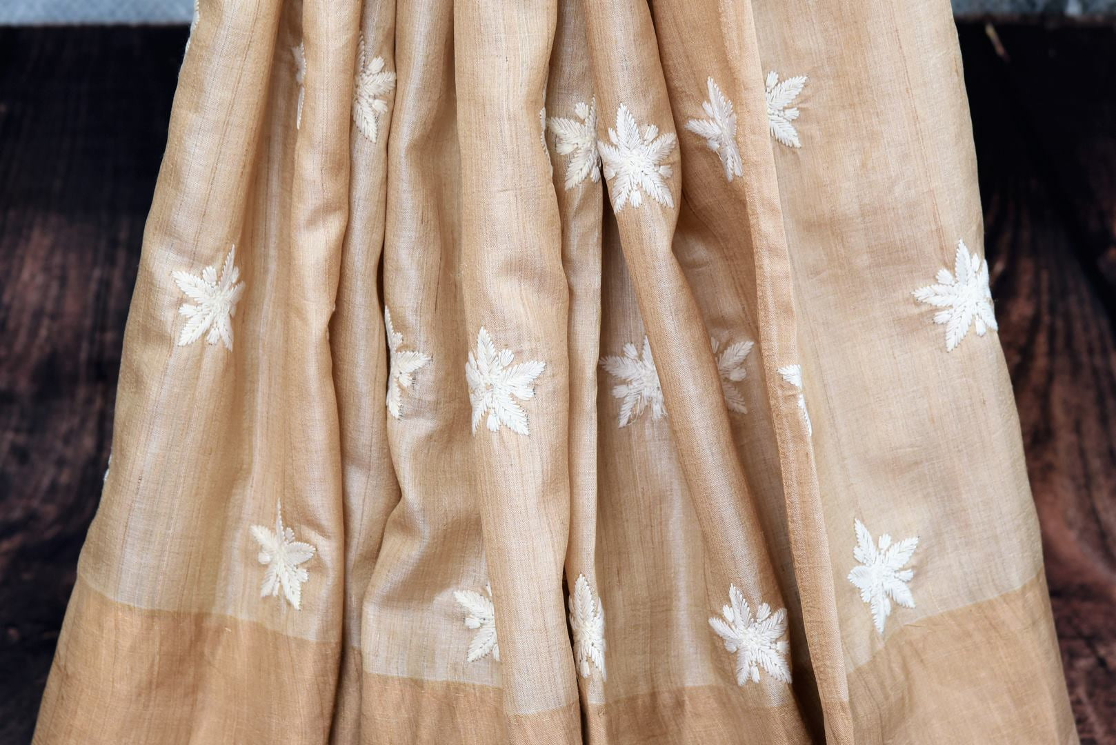 Buy elegant handwoven beige embroidered tussar silk saree online in USA. The sari comes with a matching embroidered blouse piece. Add more such beautiful Indian handloom sarees to your ethnic wardrobe from Pure Elegance exclusive Indian clothing store in USA or shop online.-pleats